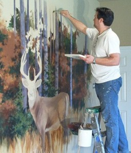Jim working on a wildlife mural project.